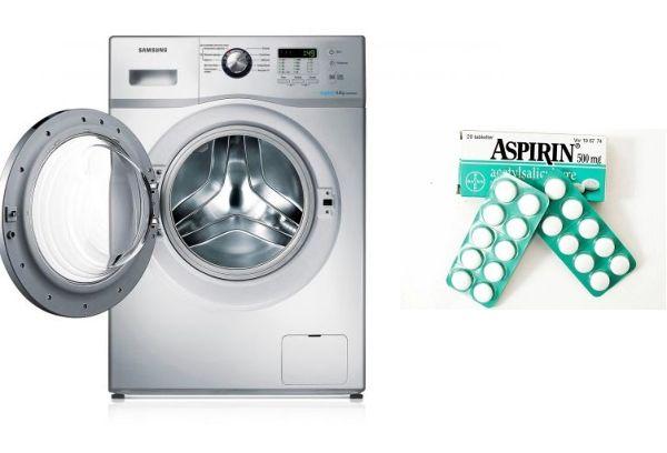 Стиральная машина и аспирин в таблетках